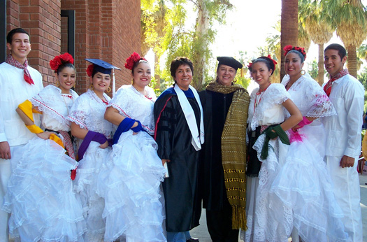 MAS professors Lydia Otero and Yolanda Broyles-Gonzalez with a local ballet folclórico group at the annual UA Hispanic Convocation.